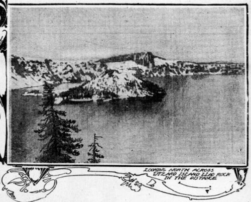 Photo of Wizard Island in Crater Lake, covered with snow.