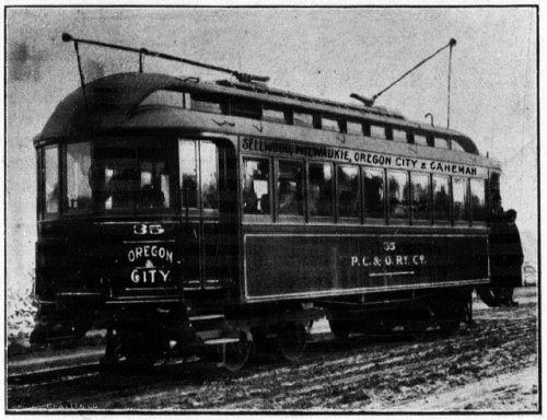 "Photograph of an electric railway car with the words ""Oregon City"" and ""Sellwood, Milwaukie, Oregon City and Canemah"" on the car, indicating the route of the train."