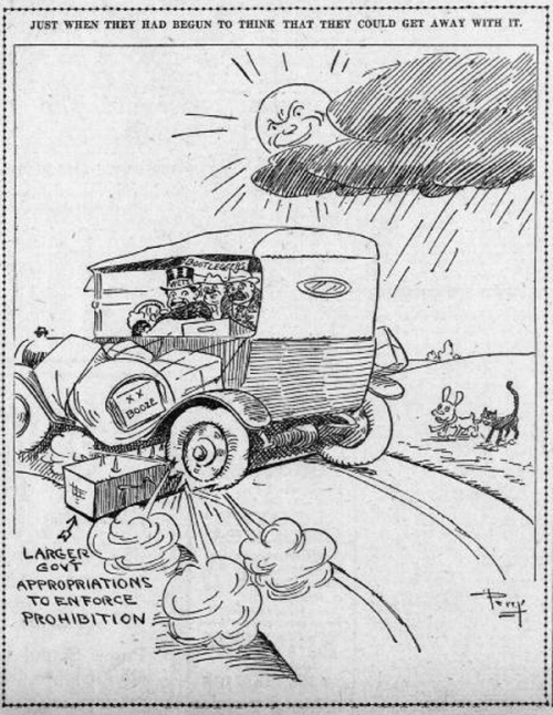 "Cartoon has caption that reads: ""Just when they had begun to think that they could get away with it."" Image shows a 1920s style car with a sign on it reading ""Bootleggers,"" with three men looking shocked out the back as their luggage, marked ""Booze,"" is falling off the car and the tires of the car are being popped by spikes on the road marked ""larger gov't appropriations to enforce prohibition."" An evil looking, smirking sun watches the scene from behind a cloud above."