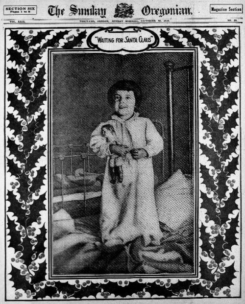 "Image of the front page of the Sunday Oregonian Magazine Section shows a full page photograph of a child in pajamas, with a decorative border of Holly leaves and berries, with caption that reads, ""Waiting for Santa Claus."""
