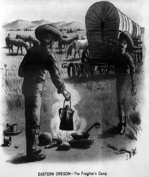 "Image shows two men in a field preparing food and drink over a small cook stove, with a covered wagon and horses grazing in the background. Caption reads: ""Eastern Oregon - The Freighter's Camp."""